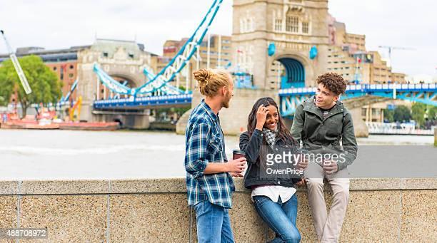 Friends talking by Tower Bridge London