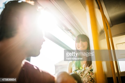 Friends talking in a bus