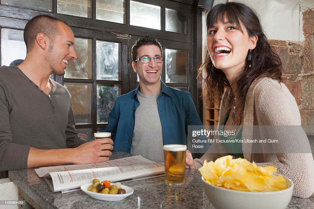 Friends talking in tapas bar : Stock Photo