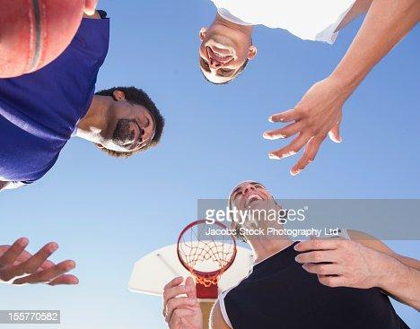 Friends talking on basketball court : Stock Photo