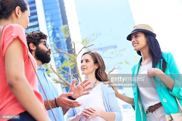 Friends talking on streets in Dubai