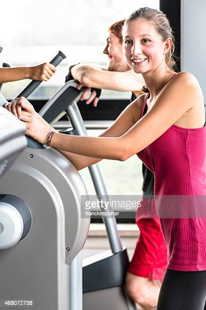 friends talking on the gym treadmill