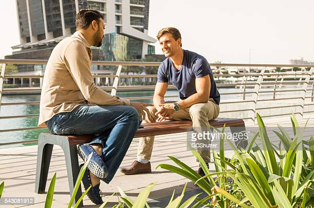 Friends talking outside their office building