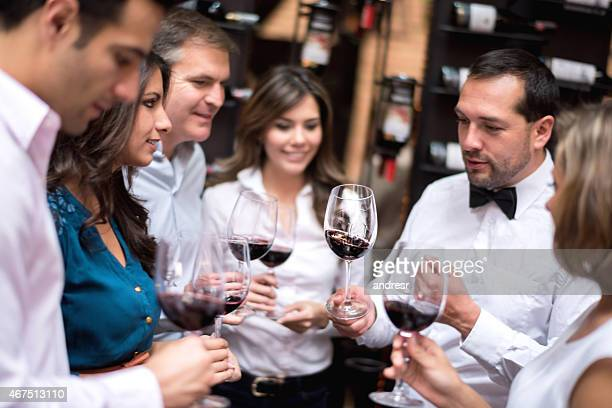 Friends tasting wine at a cellar