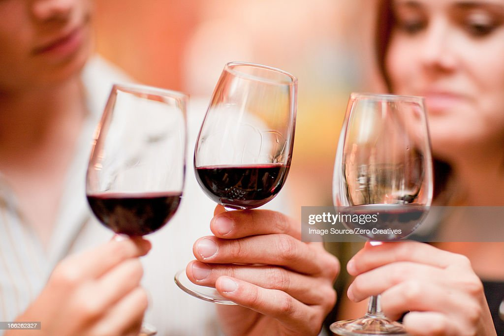 Friends tasting wine in grocery