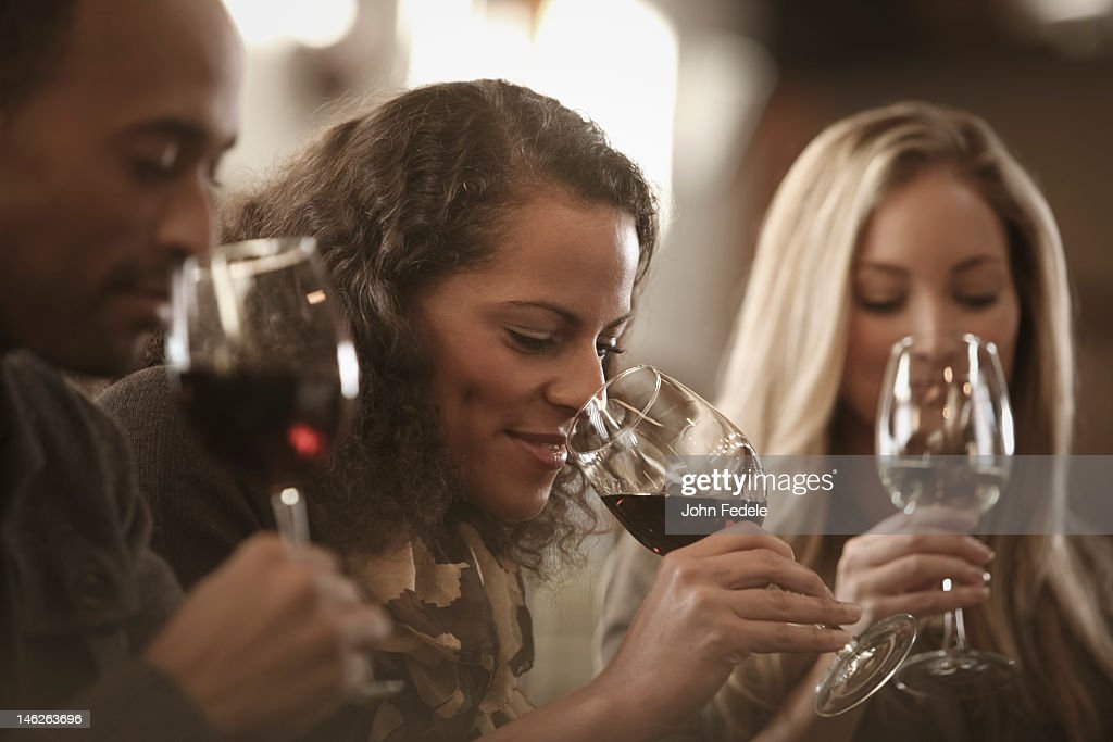 Friends tasting wine together