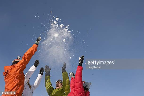 Friends throwing snow