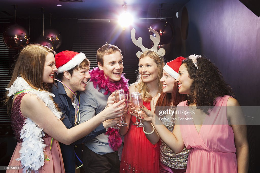 Friends toasting champagne at christmas  party : Stock Photo