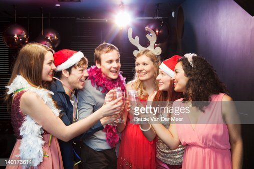 Friends toasting champagne at christmas  party : ストックフォト