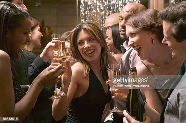 Friends toasting champagne at party
