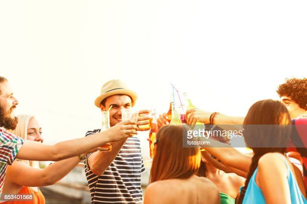 Friends toasting drinks at a party