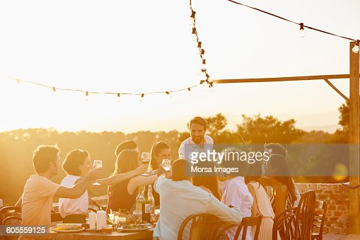 Friends toasting drinks during summer vacation
