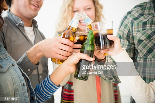 Friends toasting each other at party : Stock Photo