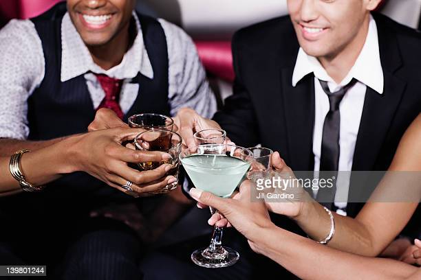 Friends toasting in nightclub