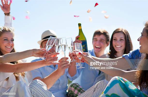 Friends toasting newlywed couple