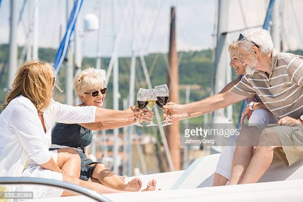 Friends Toasting Wineglasses On Yacht