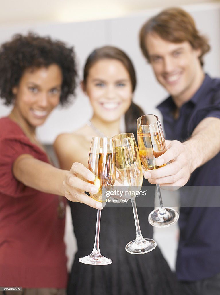 Friends toasting with Champagne at party : Stock Photo