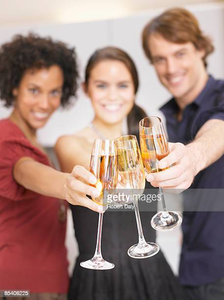 Friends toasting with Champagne at party