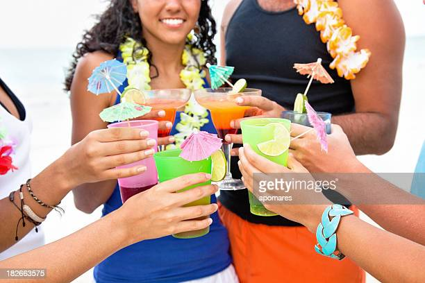 Friends toasting with tropical drinks