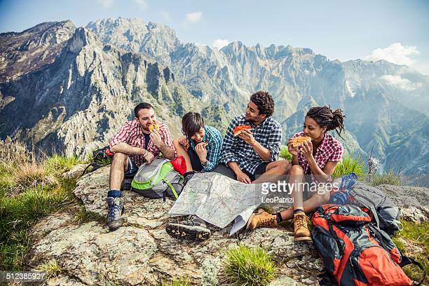 Friends together relaxing in mountain