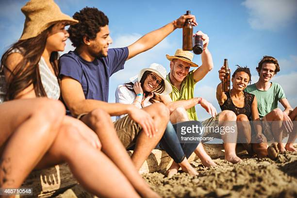 friends togetherness at beach have fun with beer