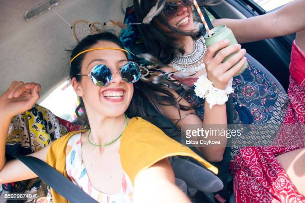 Friends traveling in car