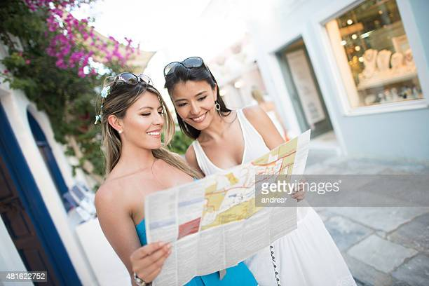 Friends traveling in Greece and looking at a map