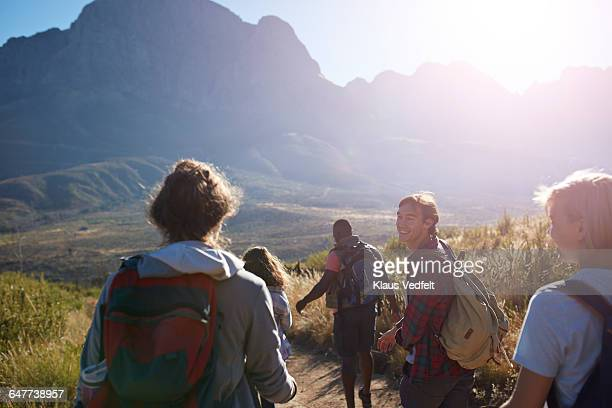 Friends trekking in the mountains and laughing