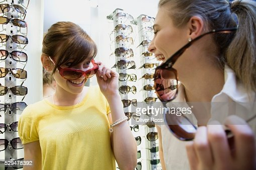 Friends trying on sunglasses : Photo