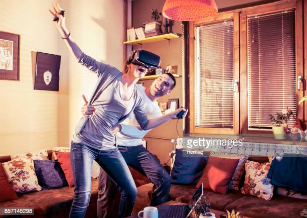 Friends trying virtual reality headset
