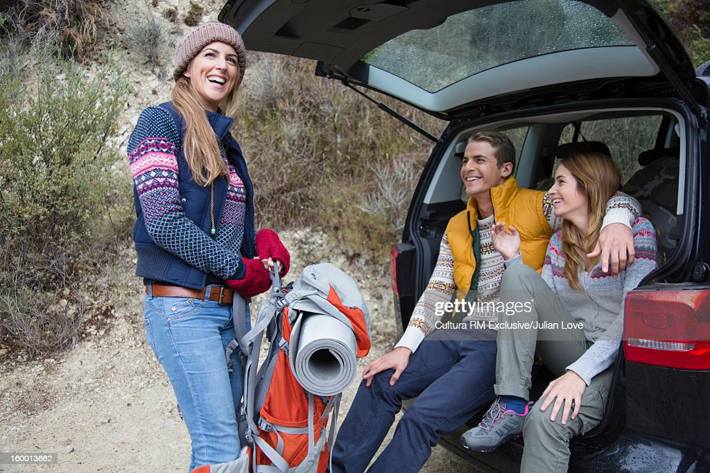 Friends unpacking camping supplies : Stock Photo