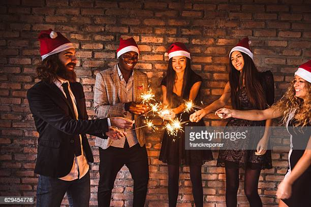 friends using a sparkler togetherness for christmas