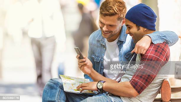 Friends using map during city trip
