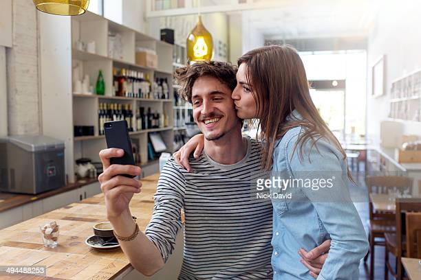 Friends using mobile phone taking a selfie