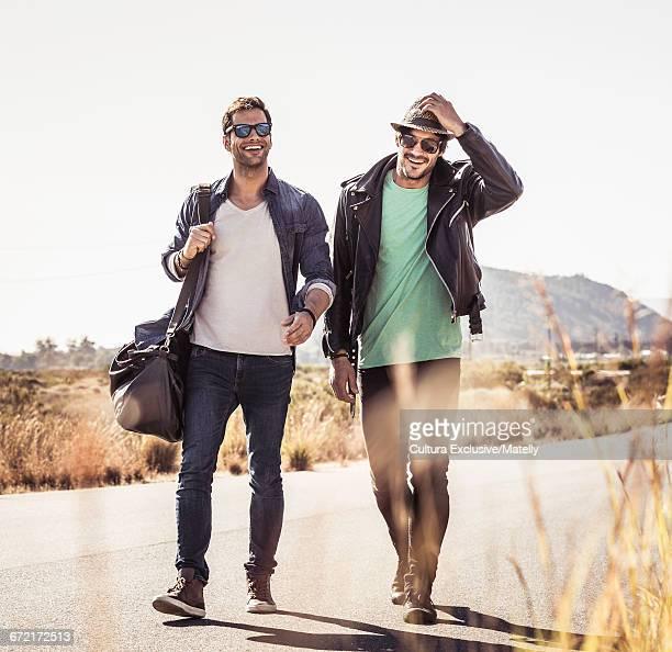 Friends walking along road, Franchoek, South Africa