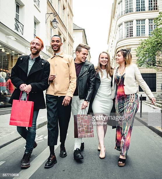 Friends walking along streets of Paris
