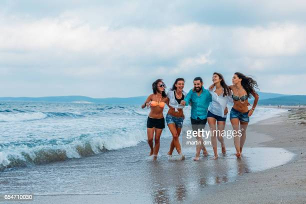 Friends walking at the beach