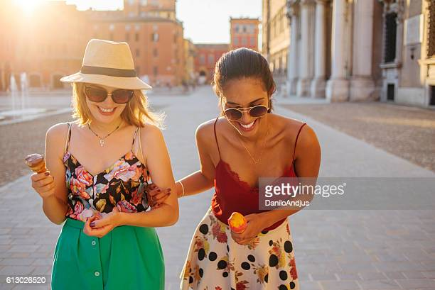 friends walking in the city enjoying a sunny day