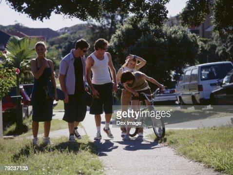 Friends walking on sidewalk : Stock Photo