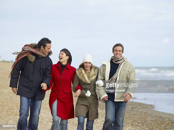 Friends walking on the beach
