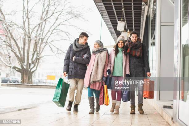 Friends walking on the street with shopping bags