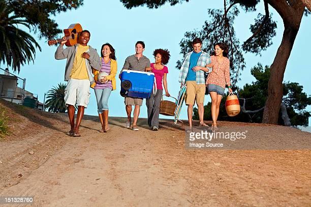 Friends walking to beach