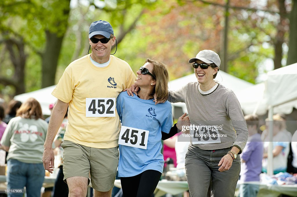 Friends walking together at a charity running race