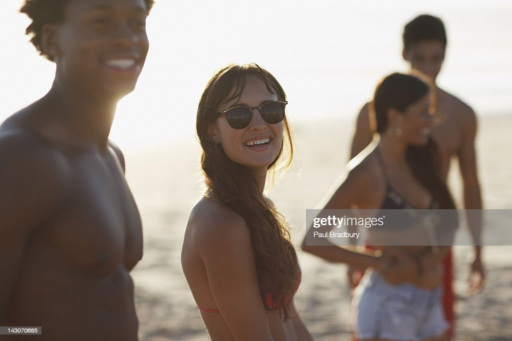 Friends walking together on beach : Stock Photo