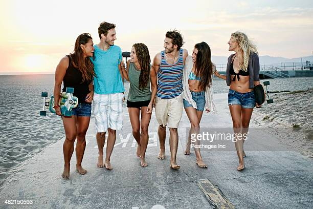 Friends walking together on beach
