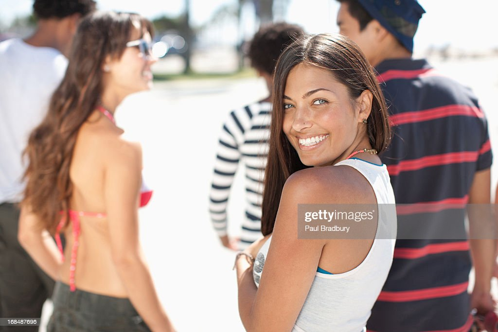 Friends walking together outdoors : Stock Photo