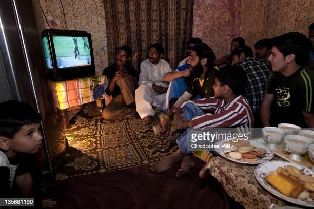Friends watch Pakistan National cricket team.
