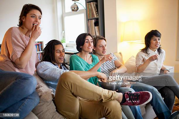 Friends watching a movie in living room