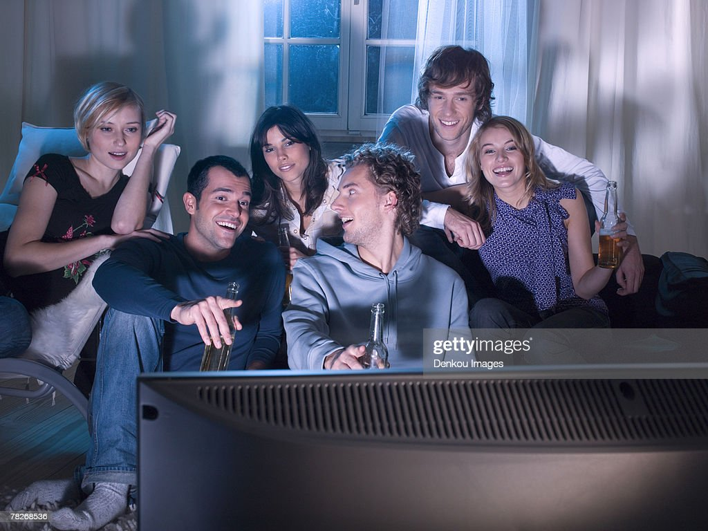 Friends watching a movie. : Stock Photo