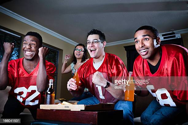 friends watching football on TV
